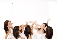Big Sign #1. Five girls in white hold a large sign on white background Stock Image