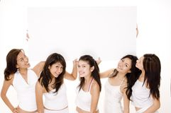 Big Sign #2. Five pretty young women hold up a large sign Stock Photography