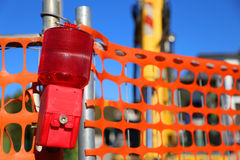 Big signal lamp of the road works and the bulldozer Stock Photos