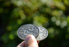 Silver coins with dragon Stock Photography