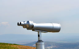 Big silver metal binoculars to see the landscape Stock Images