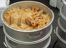 Big silver pot of tamales. Tamales in a big pot at Tamale festival Stock Image