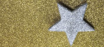 Big silver star in brilliant yellow background Royalty Free Stock Photo