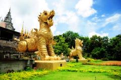 ฺBig Singhas at Mongkolkiri Samukkeedhama Temple. Big Singhas are in front of the temple. A temple in the northern Thailand city of Prae that we passed on the Stock Images