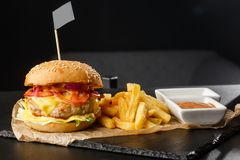 Free Big Single Chickenburger With French Fries Isolated On Black Background. Hamburger With Chicken Patty , Onion, Tomato, Lettuce Stock Photos - 163224153