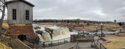 The Big Sioux River flows over rocks in Sioux Falls South Dakota with views of wildlife, ruins, park paths, train track bridge, tr. Views of the Big Sioux River Stock Images