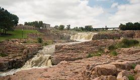 Water Flows Sioux Falls South Dakota. The Big Sioux River flows over rocks in South Dakota stock image