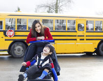 Big sister with disabled brother at school