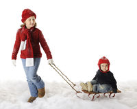 Big Sister Gives First Sled Ride Stock Photos