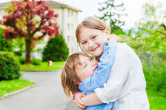 Big sister giving a hug to her toddler brother Royalty Free Stock Photos