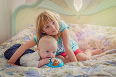 Big sister and her baby brother Stock Photo