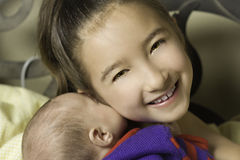 Big Sister Holding Baby Sister Stock Photography