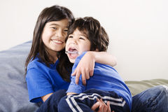 Big sister holding disabled brother stock photos