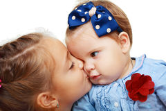 Big sister and little sister kissing Royalty Free Stock Photo