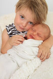 Big sister and newborn baby. Newborn baby girl and her big sister Royalty Free Stock Image