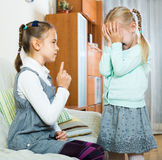 Big sister preaching little one. Annoying big american sister preaching little one and shaking finger Royalty Free Stock Image