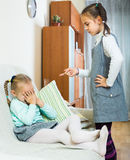 Big sister preaching little one. And shaking finger Royalty Free Stock Image