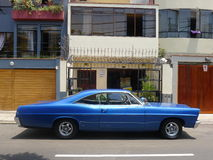 Big size blue color Ford XL coupe in Miraflores, Lima. Lima, Peru. March 12, 2016. Side view of a mint condition blue color big size Ford XL coupe collectors car royalty free stock images