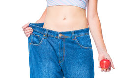 Big size old jeans on slender hips belly girl Royalty Free Stock Photos