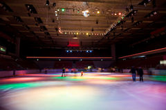Big skating rink with multi-coloured illumination Royalty Free Stock Photography