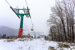Big ski lift in the fog. On top of hill Royalty Free Stock Image