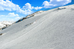 Big ski slope on a glacier with mountain peaks. French alps stock image
