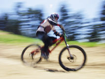 Big Sky. Pan blur effect - mountain biker Stock Images