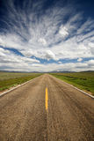 Big Sky. A lonely stretch of highway in northern Colorado Royalty Free Stock Photos