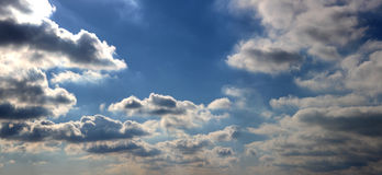 Big Sky. A partial panorama of a partly cloudy sky royalty free stock image