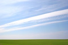 Big Sky. Diagonal clouds in a big sky over a field stock photo