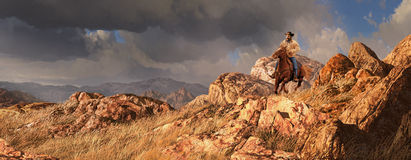 Big Sky Country. An old west scene of a cowboy riding his horse, with a rainstorm off in the distance royalty free stock image