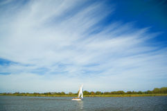 Big sky and the dingy. A scene at the english norfolk broads Stock Images