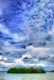 Big sky over tropical island in lagoon. Lots of clouds over mangrove island stock photography
