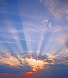 Big sky sunburst rays. Photo of big sky with sunburst sun rays shining through the clouds.photo ideal for backgrounds and text etc Stock Photo