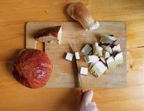 Big sliced mushroom on cutting board with knife Stock Photo