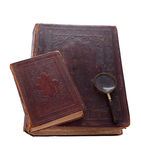 Big and small antique books and  magnifier. Two antique books, isolated white background Stock Image