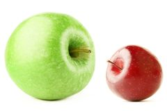 Big and small apple. Big and small. Two ripe apples, red and green isolated on white background Royalty Free Stock Photos