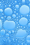 Big and small blue bubbles. Background of big and small blue bubbles forming a beautiful ornament stock photos