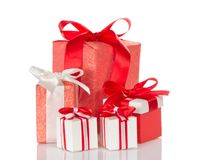 Big and small boxes with gifts, decorated with ribbons, isolated on white Stock Photography