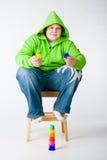Big small boy sitting on a chiar Royalty Free Stock Photo