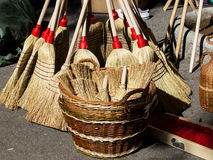 Big and small brooms Stock Image