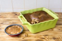 Big and small cinnamon loaf cake on wooden surface. Mother and daughter cooked cakes in oven together royalty free stock photos