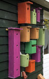 Colorful birdhouses. Big and small. Royalty Free Stock Photos