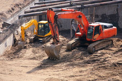 Big and small excavators Stock Photos