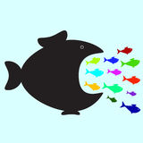 Big and small fishes. Big black fish swallowing plenty of colorful fish of different sizes and colors. Business or political concept of monopolistic company or Stock Image