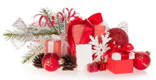 Big and small gift boxes with tapes bows. And Christmas tinsel, isolated on white Stock Image