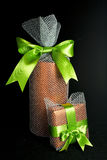 Big and small gifts. Gift boxes wrapped in red with a green bow Stock Photography