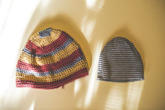 Big and small hats. Big and small winter hats. Sunlight Royalty Free Stock Photo