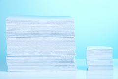 Big and small paper piles Stock Image
