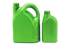 Big and small plastic lubrication oil containers Royalty Free Stock Photo